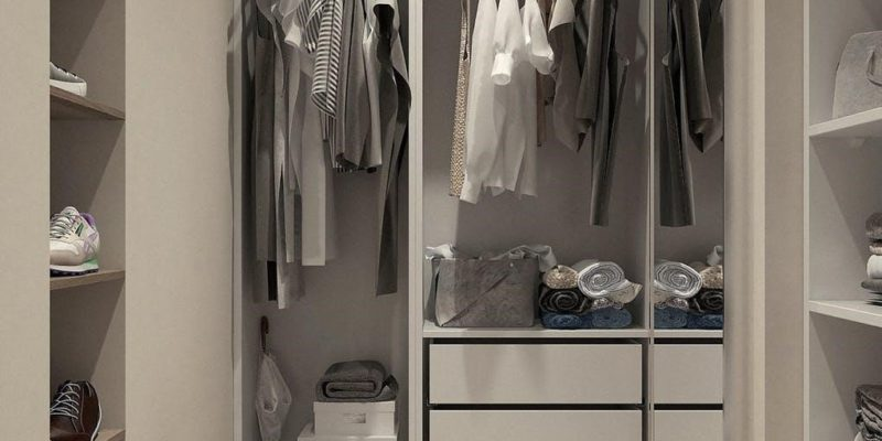 assorted-clothes-hanged-inside-cabinet